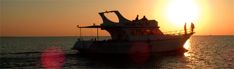 Red Sea fishing safari boat by sunset